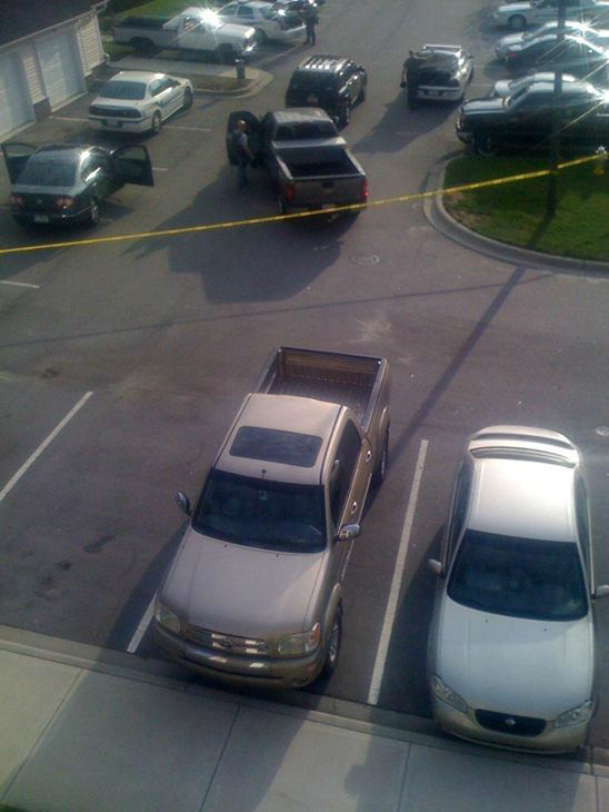 Crime tape up in front of a building at the...