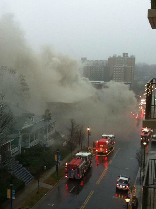 Firefighters battle a blaze on Glenwood Avenue. <span class=meta>(WTVD Photo&#47; uReport image courtesy Sean Gasperson)</span>