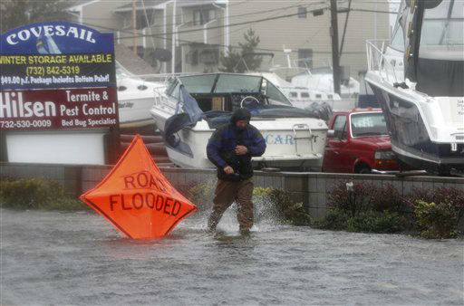 A man walks through knee-high water on the main street in Sea Bright, N.J., Monday, Oct. 29, 2012.  <span class=meta>(AP Photo&#47; Seth Wenig)</span>
