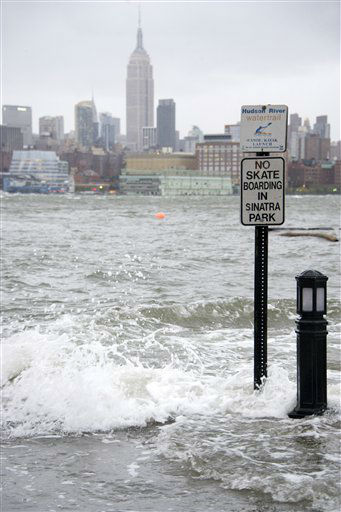 The Hudson River swells and rises over the banks of the Hoboken, N.J. waterfront as Hurricane Sandy approaches on Monday, Oct. 29, 2012. <span class=meta>(AP Photo&#47; Charles Sykes)</span>