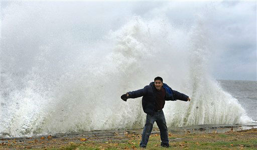 Hilavio Baquero stands in front of waves as winds from hurricane Sandy reach Seaside Park in Bridgeport, Conn., Monday, Oct. 29, 2012.  <span class=meta>(AP Photo&#47; Jessica Hill)</span>