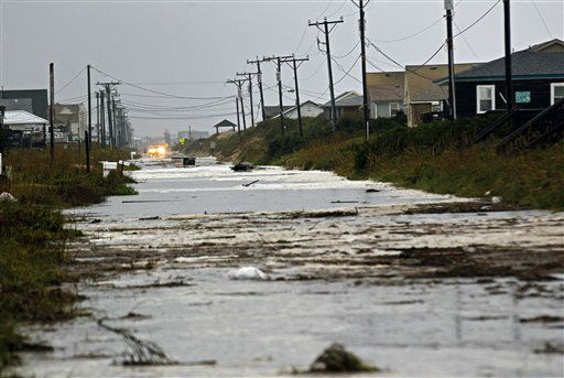 Debris and water close Virginia Dare Trail after wind and rain from Hurricane Sandy left many roads flooded and impassable in Kitty Hawk, N.C., Monday, Oct. 29, 2012.  <span class=meta>(AP Photo&#47; Gerry Broome)</span>