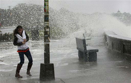 A woman reacts to waves crashing over a seawall in Narragansett, R.I., Monday, Oct. 29, 2012.   <span class=meta>(AP Photo&#47; Steven Senne)</span>