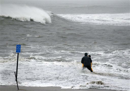 Two men wade in the rough Atlantic Ocean Monday Oct. 29, 2012, in Cape May, N.J., as Hurricane Sandy continues toward landfall. <span class=meta>(AP Photo&#47; Mel Evans)</span>