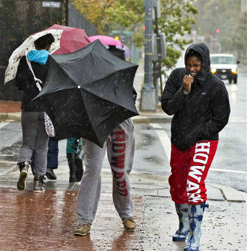 Students at Howard University return from lunch brave the wind and rain of Hurricane Sandy as the storm arrives in Washington, Monday, Oct. 29, 2012.   <span class=meta>(AP Photo&#47; J. Scott Applewhite)</span>