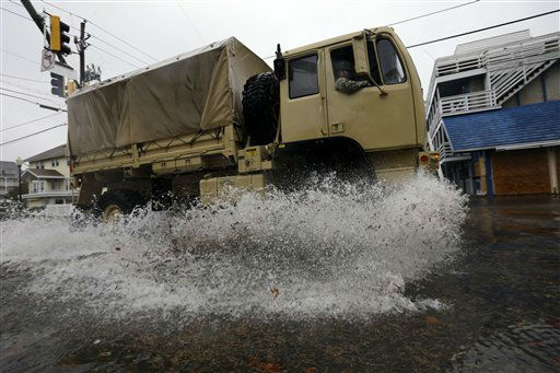 "<div class=""meta ""><span class=""caption-text "">A National Guard truck checks the area for stranded people as Hurricane Sandy bears down on the East Coast, Monday, Oct. 29, 2012, in Ocean City, Md.  (AP Photo/ Alex Brandon)</span></div>"