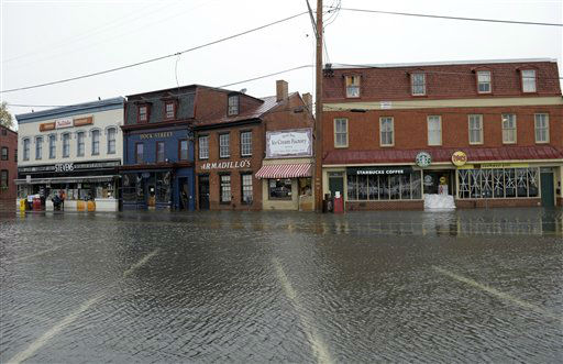 "<div class=""meta ""><span class=""caption-text "">Flood water run down part of downtown Annapolis, Md., Tuesday, Oct. 30, 2012, after the superstorm and the remnants of Hurricane Sandy passed through Annapolis.  (AP Photo/ Susan Walsh)</span></div>"