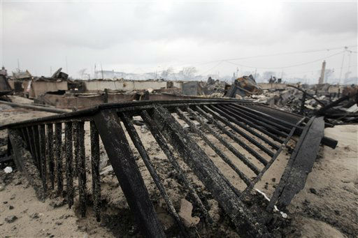 "<div class=""meta ""><span class=""caption-text "">Damage caused by a fire at Breezy Point is shown Tuesday, Oct. 30, 2012, in New York.  (AP Photo/ Frank Franklin II)</span></div>"