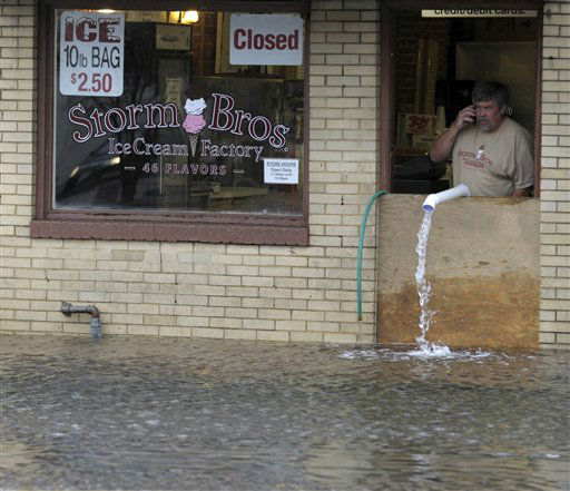 Sveinn Storm, owner of Storm Bros. Ice Cream Factory looks at flood water outside his store in Annapolis, Md., Tuesday, Oct. 30, 2012, in the aftermath of  Superstorm Sandy that passed through the East Coast.   <span class=meta>(AP Photo&#47; Susan Walsh)</span>