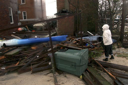 "<div class=""meta ""><span class=""caption-text "">Kim Johnson looks over debris thrown around but Storm Sandy at her apartment building on the ocean in Atlantic City, N.J., Tuesday, Oct. 30, 2012.  (AP Photo/ Seth Wenig)</span></div>"
