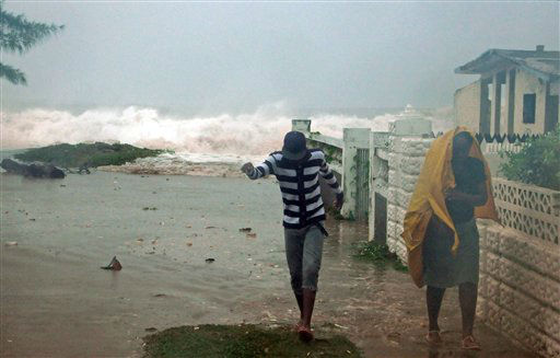 "<div class=""meta ""><span class=""caption-text "">Residents evacuate their home as waves crash in the Caribbean Terrace neighborhood of eastern Kingston, Jamaica, Wednesday, Oct. 24, 2012. (AP Photo/ Collin Reid)</span></div>"