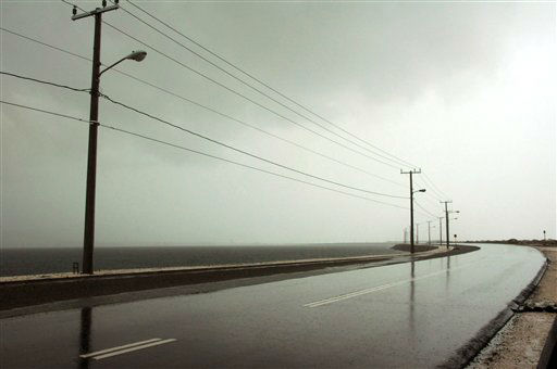 "<div class=""meta ""><span class=""caption-text "">The seaside road leading to the international airport is empty as Hurricane Sandy approaches Kingston, Jamaica, Wednesday, Oct. 24, 2012.  (AP Photo/ Collin Reid)</span></div>"