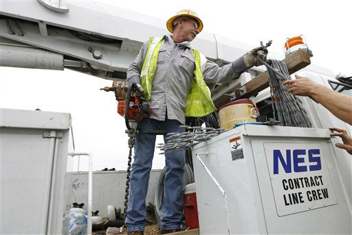 Utility worker Allen Burrow gets his gear ready at Glen Burnie, Md., facility as Hurricane Sandy approaches the Atlantic coast on Sunday,  Oct. 28,  2012.  <span class=meta>(AP Photo&#47; Jose Luis Magana)</span>