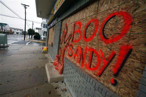 "<div class=""meta image-caption""><div class=""origin-logo origin-image ""><span></span></div><span class=""caption-text"">The boarded up windows on a store front in Margate N.J., read ""Boo Sandy!"", as the area prepares for the arrival of the superstorm, Sunday, Oct. 28, 2012.  (AP Photo/ Joseph Kaczmarek)</span></div>"