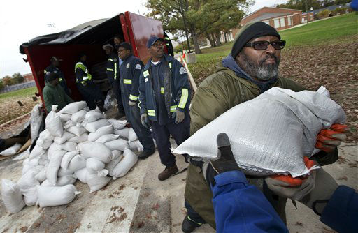 District of Columbia Department of Public Works worker Donald Jackson, right, passes a sandbag from the line of fellow workers handing out free sandbags to District of Columbia residents in Washington, Sunday, Oct. 28, 2012, ahead of Hurricane Sandy.  <span class=meta>(AP Photo&#47; Manuel Balce Ceneta)</span>