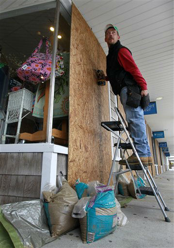 Jeremy Seidel, of Waterford, Conn., reaches in his pocket for screws while covering storefront windows with plywood in the Watch Hill section of Westerly, R.I., Sunday, Oct. 28, 2012, in preparation for high winds from the expected arrival of Hurricane Sandy.  <span class=meta>(AP Photo&#47; Steven Senne)</span>
