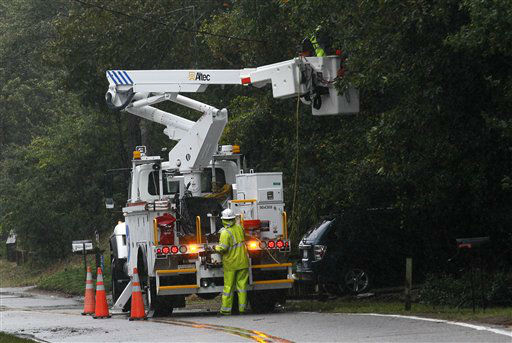 Utility workers with Dominion repair lines damaged by Hurricane Sandy in Colington, N.C., Sunday, Oct. 28, 2012 as the storm moves up the east coast.  <span class=meta>(AP Photo&#47; Gerry Broome)</span>