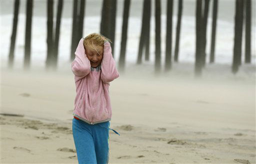 "<div class=""meta ""><span class=""caption-text "">Molly White, 9, from Frankford, Del., covers her head as she is pelted by blowing sand on the beach, as Hurricane Sandy bears down on the East Coast, Sunday, Oct. 28, 2012, in Ocean City, Md.  (AP Photo/ Alex Brandon)</span></div>"