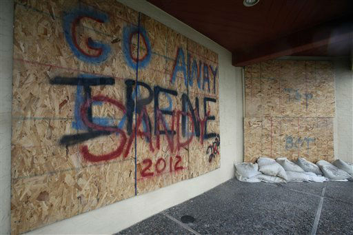 "<div class=""meta ""><span class=""caption-text "">A boarded up beachfront home in Margate N.J.  is repainted for a new hurricane threat as Hurricane Sandy approaches the area, Sunday, Oct. 28, 2012.  (AP Photo/ Joseph Kaczmarek)</span></div>"
