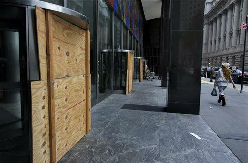 "<div class=""meta ""><span class=""caption-text "">Plywood covers the revolving doors in preparation for Hurricane Sandy at the 2 Broadway building of Lower Manhattan in New York, Sunday, Oct. 28, 2012.  (AP Photo/ Craig Ruttle)</span></div>"