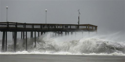 "<div class=""meta ""><span class=""caption-text "">Waves crash into the Ocean City Fishing Pier as Hurricane Sandy bears down on the East Coast, Sunday, Oct. 28, 2012, in Ocean City, Md.  (AP Photo/ Alex Brandon)</span></div>"