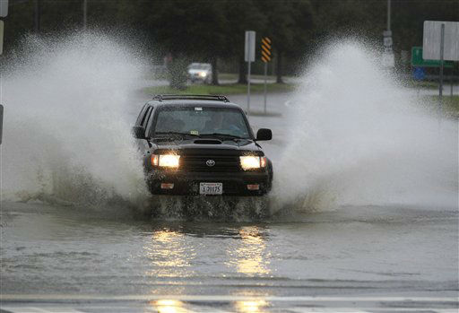 "<div class=""meta ""><span class=""caption-text "">A car plows through a flooded street in the Ocean View area  in Norfolk, VA., Sunday, Oct. 28, 2012.   (AP Photo/ Steve Helber)</span></div>"