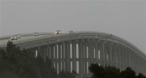 "<div class=""meta ""><span class=""caption-text "">Vehicles drive across Roanoke Sound leaving Hatteras Island in Nags Head, N.C., as as Hurricane Sandy churned up the east coast Saturday, Oct. 27, 2012.  (AP Photo/ Gerry Broome)</span></div>"