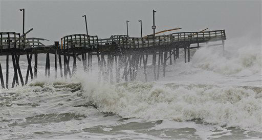 "<div class=""meta ""><span class=""caption-text "">Waves from Hurricane Sandy crash onto the damaged Avalon Pier in Kill Devil Hills, N.C., Monday, Oct. 29, 2012. (AP Photo/ Gerry Broome)</span></div>"