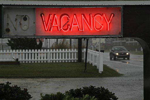 "<div class=""meta ""><span class=""caption-text "">A car drives past a vacancy sign in front of the Outer Banks Motor Lodge in Kill Devil Hills, N.C., Sunday, Oct. 28, 2012. (AP Photo/ Gerry Broome)</span></div>"