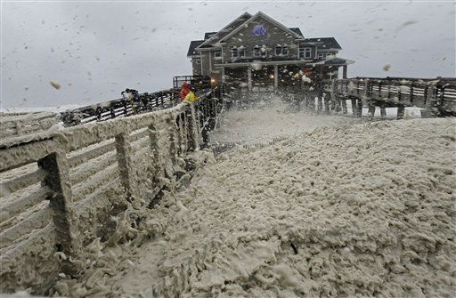 High winds blow sea foam onto Jeanette&#39;s Pier in Nags Head, N.C., Sunday, Oct. 28, 2012. <span class=meta>(AP Photo&#47; Gerry Broome)</span>