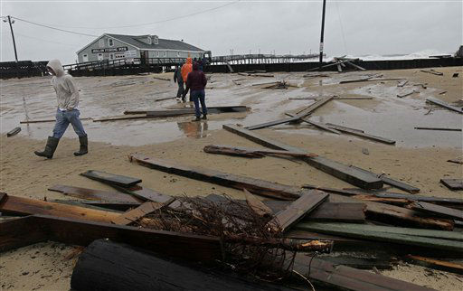 "<div class=""meta ""><span class=""caption-text "">Debris from a sea wall and a damaged pier litters a parking lot at Avalon Pier in Kill Devil Hills, N.C., Monday, Oct. 29, 2012. (AP Photo/ Gerry Broome)</span></div>"