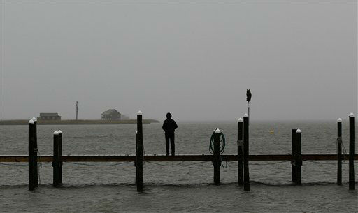 "<div class=""meta ""><span class=""caption-text "">Corissa Martinez looks out over the Pamlico Sound in Nags Head, N.C., Saturday, Oct. 27, 2012 as Hurricane Sandy churned up the east coast.  (AP Photo/ Gerry Broome)</span></div>"