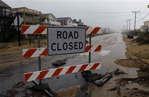 A sign warns motorists of a closed beachfront road in Kill Devil Hills, N.C., Sunday, Oct. 28, 2012 as the storm moved up the east coast. <span class=meta>(AP Photo&#47; Gerry Broome)</span>