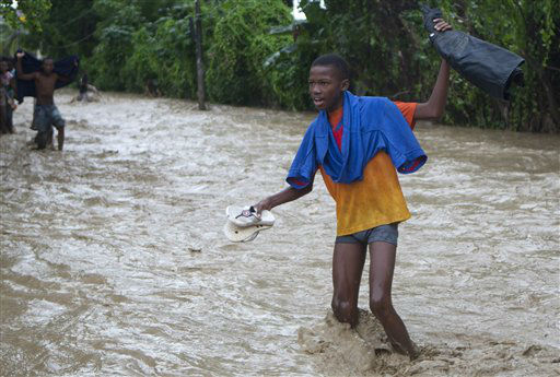 Residents wade through a street flooded by heavy rains from Hurricane Sandy in Port-au-Prince, Haiti, Thursday, Oct. 25, 2012.  <span class=meta>(AP Photo&#47; Dieu Nalio Chery)</span>