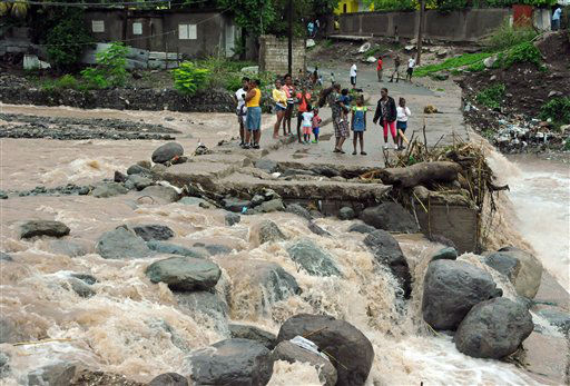 "<div class=""meta image-caption""><div class=""origin-logo origin-image ""><span></span></div><span class=""caption-text"">Residents stand on a bridge that was previously destroyed in 2008 by Tropical Storm Gustav, while watching Hope River swell in the village of Kintyre, near Kingston, Jamaica, after the passing of Hurricane Sandy, Thursday, Oct. 25, 2012. (AP Photo/ Collin Reid)</span></div>"