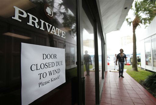 A sign on a door of a Fort Lauderdale, Fla.,  building warns of windy conditions, Thursday, Oct. 25, 2012.  <span class=meta>(AP Photo&#47; Wilfredo Lee)</span>