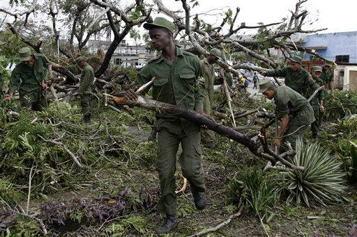 Soldiers removes trees that fell during the passing of Hurricane Sandy in Santiago de Cuba, Cuba, Friday Oct. 26, 2012. <span class=meta>(AP Photo&#47; Franklin Reyes)</span>