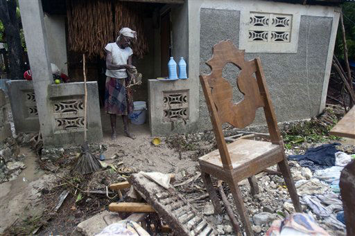 A woman cleans her home, drenched by the heavy rains from Hurricane Sandy in Gran Goave, Haiti, Friday, Oct. 26, 2012.  <span class=meta>(AP Photo&#47; Dieu Nalio Chery)</span>