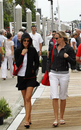 Attendees at the Fort Lauderdale International Boat Show walk in the breezy drizzly weather, Thursday, Oct. 25, 2012 in Fort Lauderdale, Fla. <span class=meta>(AP Photo&#47; Wilfredo Lee)</span>