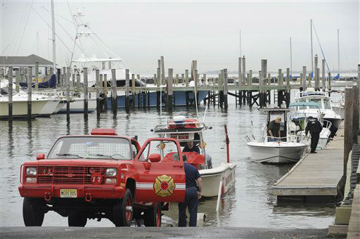 As Hurricane Sandy moves up the East Coast, members of the Highlands Fire Department remove the rescue boat from the Atlantic Highlands Marina, Friday Oct. 26, 2012 in Atlantic Highlands, N.J.  <span class=meta>(AP Photo&#47; Joe Epstein)</span>