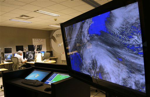A satellite image of Hurricane Sandy is shown on a computer screen at the National Hurricane Center in Miami on Friday, Oct. 26, 2012.  <span class=meta>(AP Photo&#47; Lynne Sladky)</span>