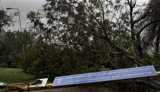 "<div class=""meta image-caption""><div class=""origin-logo origin-image ""><span></span></div><span class=""caption-text"">A transit sign that reads in Spanish ""Revolution Square"" lies on the ground next to a fallen tree after the passing of Hurricane Sandy in Santiago de Cuba, Cuba, Thursday Oct. 25, 2012.   (AP Photo/ Franklin Reyes)</span></div>"