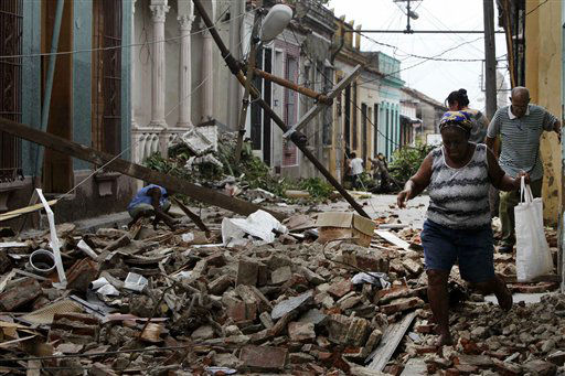 "<div class=""meta ""><span class=""caption-text "">Residents walk through the rubble from homes that were damaged by Hurricane Sandy in Santiago de Cuba, Cuba, Friday Oct. 26, 2012.  (AP Photo/ Franklin Reyes)</span></div>"