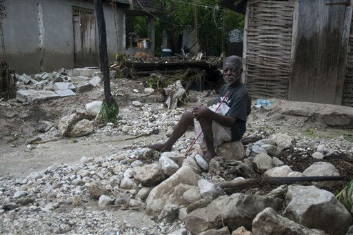 "<div class=""meta ""><span class=""caption-text "">A man sits in front of his home, on debris left by a flood caused by the heavy rains from Hurricane Sandy in Gran Goave, Haiti, Friday, Oct. 26, 2012.  (AP Photo/ Dieu Nalio Chery)</span></div>"