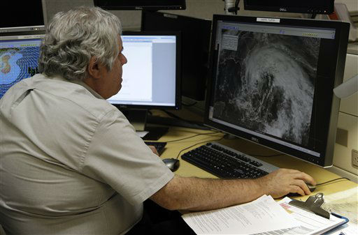 "<div class=""meta ""><span class=""caption-text "">Hurricane specialist Richard Pasch looks at a satellite image of Hurricane Sandy at the National Hurricane Center, Friday, Oct. 26, 2012, in Miami.  (AP Photo/ Lynne Sladky)</span></div>"