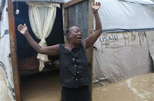 A woman cries out in front of her flooded house caused by heavy rains from Hurricane Sandy in Port-au-Prince, Haiti, Thursday, Oct. 25, 2012.  <span class=meta>(AP Photo&#47; Dieu Nalio Chery)</span>