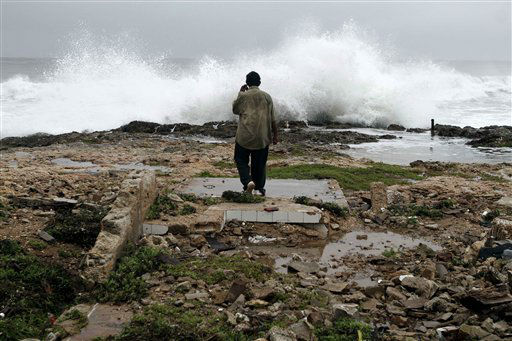 A man walks amid ruins of a home destroyed by Hurricane Sandy in Gibara, Cuba, Thursday, Oct. 25, 2012. <span class=meta>(AP Photo&#47; Franklin Reyes)</span>