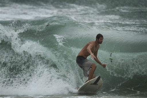 A surfer at the Boynton Beach, Fla. inlet battles the rough surf Thursday, Oct. 25,2012.  <span class=meta>(AP Photo&#47; J Pat Carter)</span>