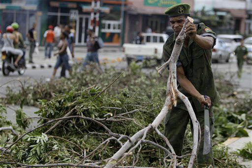 A soldier removes tress that fell during the passing of Hurricane Sandy in Santiago de Cuba, Cuba, Friday Oct. 26, 2012.  <span class=meta>(AP Photo&#47; Franklin Reyes)</span>