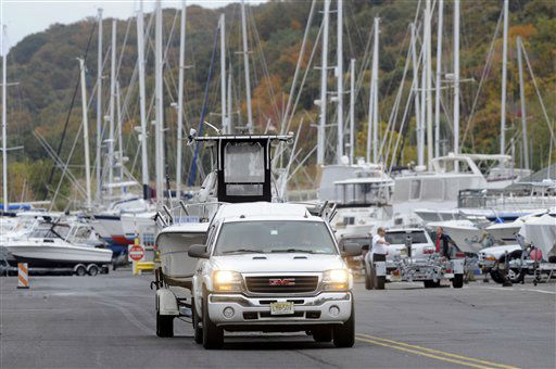 As Hurricane Sandy moves up the East Coast, owners remove their boats from the water at the Atlantic Highlands Marina, Friday Oct. 26, 2012 in Atlantic Highlands, N.J.  <span class=meta>(AP Photo&#47; Joe Epstein)</span>